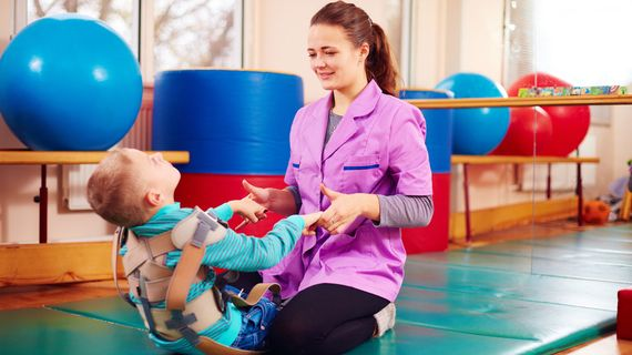 A child with cerebral palsy receiving physiotherapy treatment.